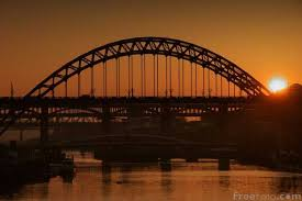dark-bridge-and-orange-skies